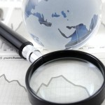 iStock_000007184986_Large_magnify+globe over financial paper